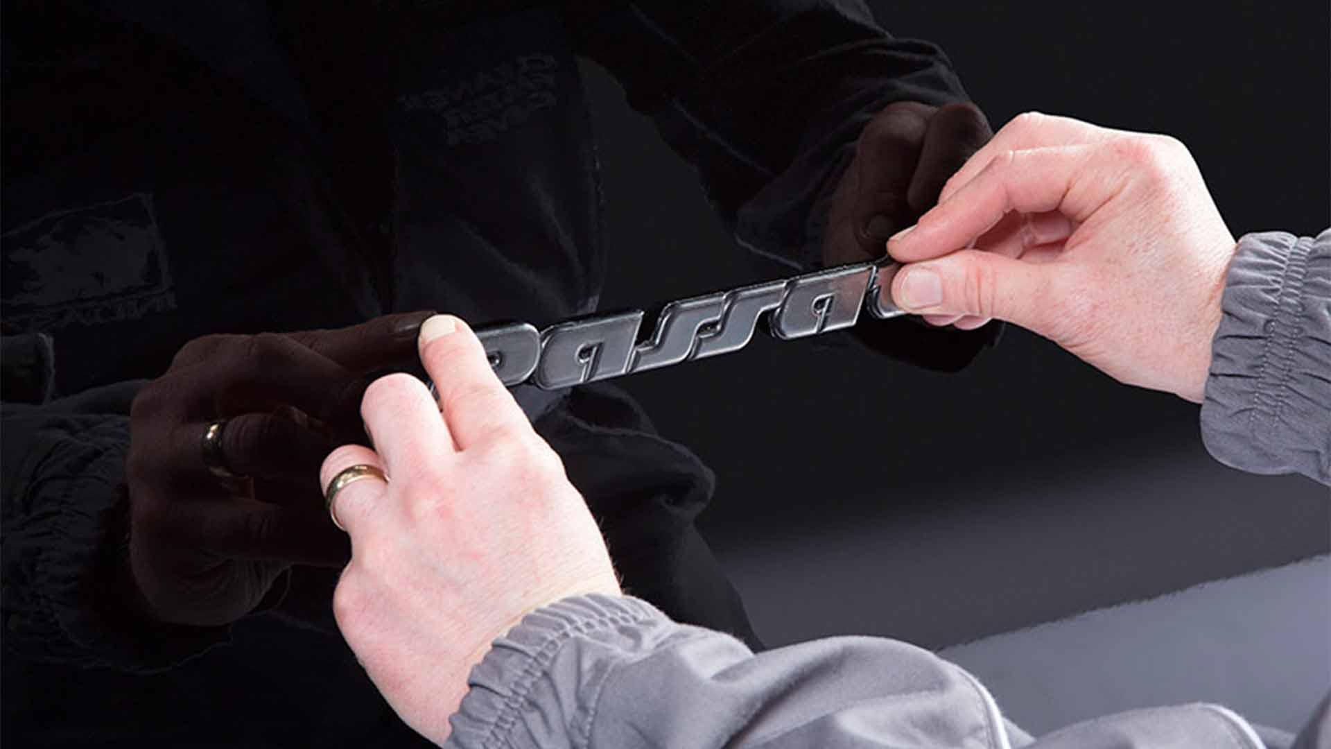 INDASA Abrasives Emblem Tape applying on car