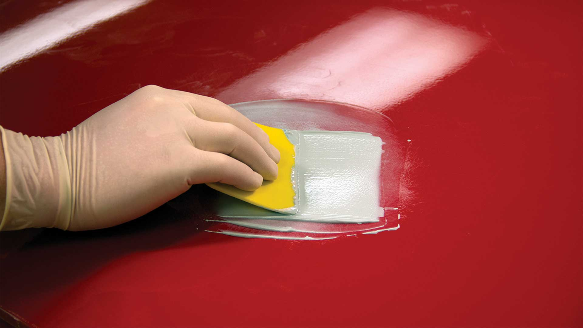 Evercoat Rage Ultra on red surface